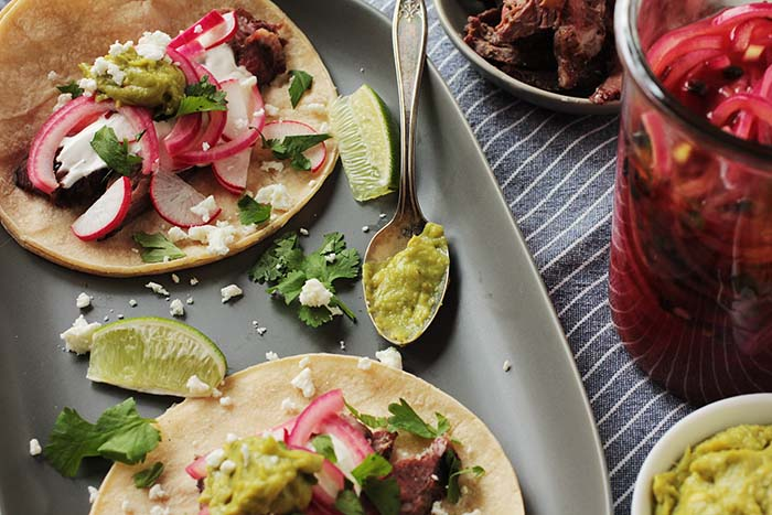 Post image for SKIRT STEAK TACOS W PICKLED PURPLE ONIONS & GUACAMOLE